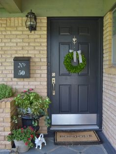 """Spruce up that mailbox. Clean it off and add house numbers, the word """"mail"""" or a design that strikes your fancy. Abilene, TX: Camille Dickson - eclectic - entry - Other Metro - Sarah Greenman Yellow Brick Houses, Brick House Colors, Brick Ranch Houses, Exterior House Colors, Grey Front Doors, Painted Front Doors, Front Door Colors, Black Doors, Light Brick"""