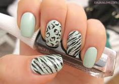 Cheetah and zebra nails with light turquoise