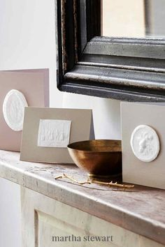 The tools you need to craft these cameo-like cards come from the kitchen: They're traditional European springerle-cookie molds. We filled them with pulp made from cotton-linter paper instead of dough, then glued the textured medallions onto cards. The finished pieces make graceful ornaments, as well. #marthastewart #christmas #diychristmas #diy #diycrafts #crafts