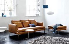 Beautiful Istra sofa in brown leather fits perfectly in this warehouse loft.