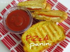 Pizza Panini. Sooo good. We used a George Foreman to press the sandwiches, but you could use two skillets: one to cook and the bottom of the other to press.