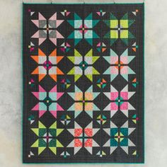 dash to the Finish On the Boardwalk Square One quilt kit by Craftsy.    Modern take on the traditional variable star quilt block.  Layer cake   friendly quilt pattern.  Affiliate link.
