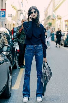 Model-Off-Duty-Style: Antonina Petkovic's goes laid-back cool in sunglasses, a turtleneck sweater, flared jeans and white sneakers: