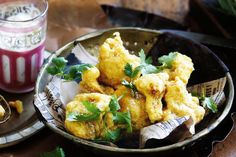 These golden nuggets of spicy fried cauliflower are delicious dipped in cooling tzatziki.