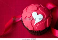 Cupcake decorated with fondant hearts - Stock Image
