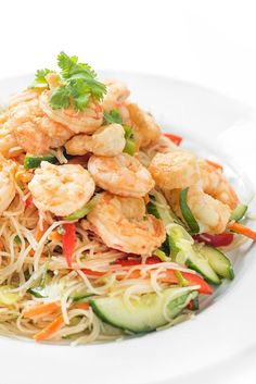 This bright and fresh Thai shrimp salad is made with rice noodles and crunchy vegetables then tossed in a tangy, tamarind-lime vinaigrette.