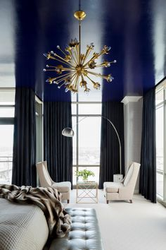 The industrial statement light trend isn't anything new. The look was a popular feature in midcentury design, making the mod-style sputnik chandelier the prime for a comeback. Tobi Fairley selected a sputnik light with a brass finish to pop against the moody hue of the ceiling in this bold master bedroom suite.