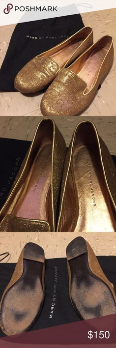 Gold Marc by Marc Jacobs Loafers Marc by Marc Jacobs Loafers • Gold loafer Logo || Black bottom  • Size 7.5 || True to Size • Comes with Authentic Dustbag; purchased in bloomingdales 3+ years ago • LOVED IN NYC || the bottom is a bit worn - but still in great condition! Marc by Marc Jacobs Shoes Flats & Loafers
