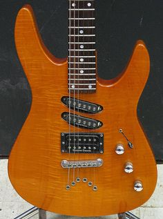 """A true one of a kind guitar that was custom manufactured by Jon Hill at Dean USA in 1996. The guitar is based on the ACXL model that was offered in that year and was customized with a 1/4"""" flamed mapl"""