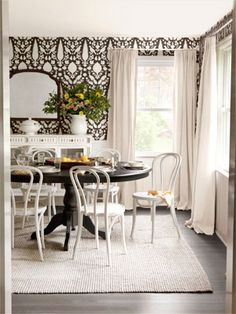 A wallpaper swap—and some savvy catalog shopping—dramatically changed the tune of this space in no time flat. #decoratingideas