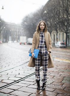 Camel wool coat, blue clutch, plaid pants, plaid shirt, black leather buckled heels / Garance Doré