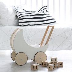 Our toy pram is really the crescent moon, which we have brought down from the sky. For you and your little ones.