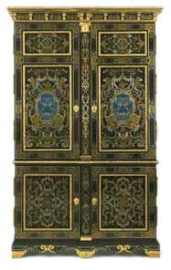 French Baroque Cupboard, 1700. Ebony veneer, with marquetry of engraved pewter and brass and panels of clear horn over blue pigment, on an oak carcase.