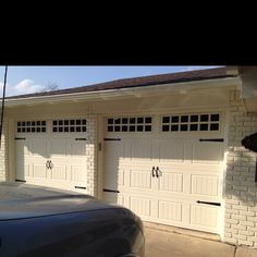 Painted brick and garage doors. Color: Parmesan.