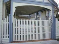 wood fence overhead lift gate for carport