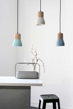 Cement Wood Lamps: Beech wood and colored cement pendant lamps by Decha Archjananun/Ecal