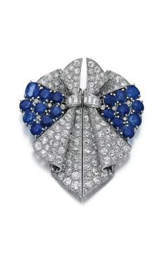 Sapphire and diamond double clip brooch, 1930s.