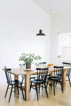 Chic cottage dining room features a farmhouse dining table lined ...