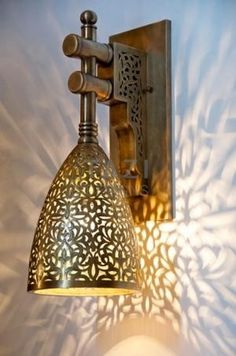"Moorish Wall Light / Look these at WWW.COM / ""Online boutique dedicated to select fashion, art and decoration accessories of African-inspired designs"" / Ethnic Global African Home Decor and Style… Moroccan Home Decor, Moroccan Lighting, Moroccan Lamp, Moroccan Lanterns, Moroccan Interiors, Modern Moroccan, Design Marocain, Bathroom Wall Decor, Moorish"