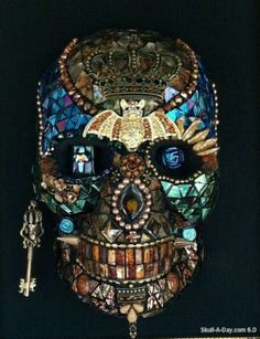 Skull mosaic by Janice Nunez ~ I'm not usually that  into sculls, but this one is uniquely done.