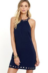 Lulus Exclusive! Give the next place you wear the What a Stud Navy Blue Dress a reputation for attracting the hottest girls! Stretch woven fabric falls from a gold grommet-accented neckline into a darted, sheath silhouette. More grommets at the hem tie the whole look together. Hidden zipper and button closures at back. #CuteDresses #TrendyTops, #FashionShoes #JuniorsClothing