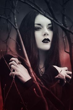 Black hair and pale skin, black lipstick and red wine velvet. So witchy, so dreamy. Maiden witch.