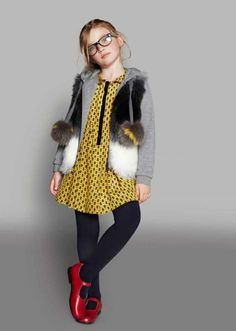 Dress and hoodie by Fendi, fun fur gilet by IKKS, shoes by Start-Rite all from Alex and Alexa for fall 2014