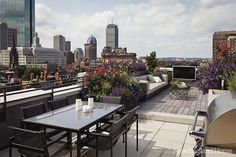 A skyline view from a Back Bay roof deck. Photo by Trent Bell