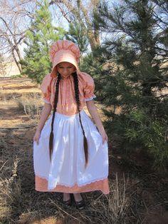 Handmade Girls Orange Floral Pioneer Dress Bonnet and Apron Set child size 5 to 6. $55.50, via Etsy.