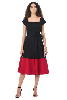 Our stretch cotton poplin shirtdress is capped with a wide square neck and the sash tied waist nips in the silhouette above a full skirt with vibrant banding at the hem that gently swishes as you move.