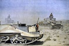 """German tanks PzKpfw IV Ausf.F drive past downed and captured British armored """"Bren Carrier"""" (version with 13.9 mm anti-tank gun """"Boys""""). Bronetransortere decomposed on the German flag to prevent attacks from the Italian and German Air Force."""