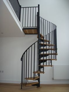The Stratford Spiral Stair .... Need somehow to merge spiral similar to this with wooden staircase and spindles? Any suggestions? ......