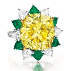 Fancy Intense yellow diamond, emerald and diamond ring. Image courtesy of Christie's Images LTD. 2013. GIA (052913)