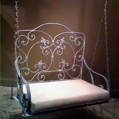I AM IN LOVE W/ THIS, & want it!!!!  Add a great vintage look to your outdoor setting with this lovely wrought iron swing. Featuring intricate iron work and a fine antiqued finish it is both elegant and comfortable. Perfect for a porch s...