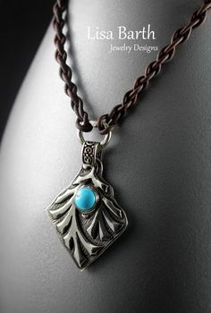 This is fine silver pendant with a bezel set Sleeping Beauty Turquoise cab that I made today.  I also made a four strand leather braid for the necklace.  It is rustic but I like that look. --Lisa Barth