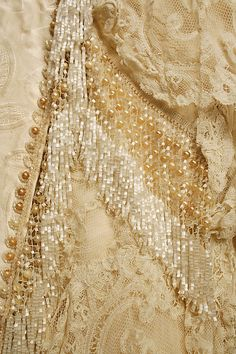 Wedding Dress.  Date: 1890s. Culture: American. Medium: silk, cotton, beads. Dimensions: (a) Length at CB: 11 in. (27.9 cm). (b) Length at CB: 63 in. (160 cm).