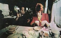 David Bowie as Ziggy Stardust having a meal in a train