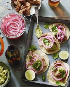 slowly roasted pork that falls apart to make carnitas tacos! Topped with guacamole and pickled onions!