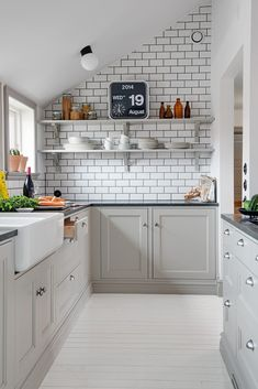 Nordic kitchen. White subway tiles with black grout, Flip clock