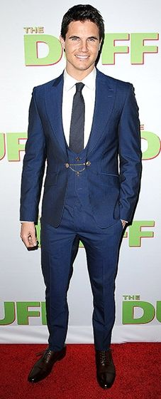 The handsome actor donned a navy blue three-piece suit, complete with a waistcoat chain.
