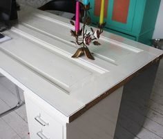 Make your own personal desk, by using an old door, on top of that an acrylic plate. As tablelegs, and also storage, use perhaps Ikeas drawer units!