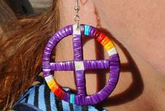 "Medicine Wheel Quillwork Earrings  Limited quantities available. Colors may vary  Lakota Medicine Wheel Quillwork Earrings (Purple featured with Laurel Burch Silk Scarf ""Wild Horses on Fire"" LB#177) Materials: Handmade dyed porcupine quillwork earrings wrapped on white buckskin. 2"" in. Pattern designs and color vary."