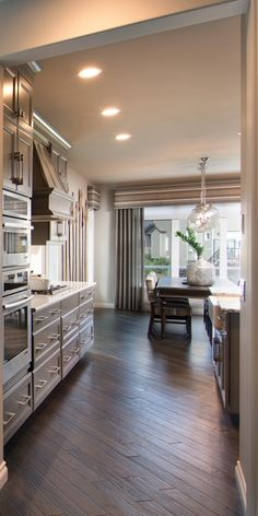 Morrison Homes is a Calgary Home Builder, specializing in front garage homes, luxury estate, quick possession homes & townhomes. Visit a show home today! Calgary News, Morrison Homes, Luxury Estate, Kitchen Dining, Dining Room, Home Builders, Townhouse, New Homes, Auburn