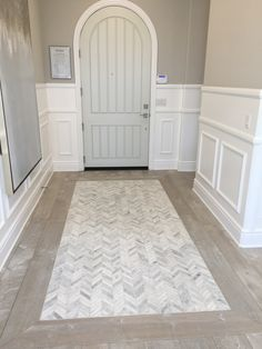 Herringbone pattern herringbone pattern wood flooring for Tiled hallway floor ideas