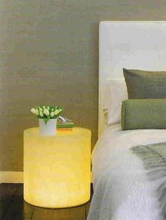 Do you wish to have modern bedside tables in your bedroom? If so there is a very cheap and cool solution for you. Buy a large fiberglass planter, drill a hole in its back and add lighting. You can use any lights you like so the bedside table can become a great mood light for your bedroom.