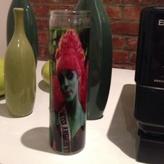 Beetlejuice Miss Argentina Candle Miss Argentina Candle from Beetlejuice. Used as decoration during a Halloween party. Candle was burned. About 75% of wax candle remains. Other