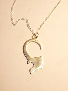 Loki Pendant: this is awesome, I might seriously consider wearing this...