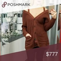 BRICK COLOR SHOULDER DETAILED SWEATER Brand new! Boutique item  Add a new twist your cardigan collection with this brick colored, cold shoulder, semi-sweetheart neckline, button-up detail cardigan sweater with our favorite detail POCKETS! This color is on trend and looks fab! Pair with our thick black leggings or when ripped jeans!  Modeling a small Material  65% acrylic 20% polyester 15% nylon   Christmas holiday brown off shoulder . Sweaters Cardigans