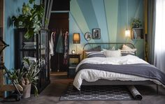 A bedroom is styled as a modern take on Art Nouveau - love the wall stripes and colors