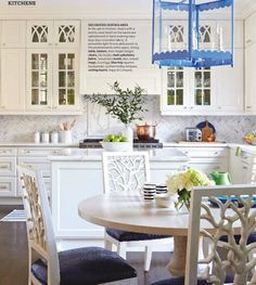 Marble Herringbone backsplash+colorful lantern=perfection!
